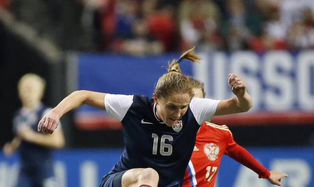 United States' Rachel Van Hollebeke (16) runs down the ball in the first half of an exhibition soccer match against Russia on Thursday, Feb. 13, 2014, in Atlanta. (AP Photo/John Bazemore)