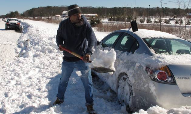 Dennis Lawrence spent several hours digging out his car from the side of Sunrise Highway in Patchogue, N.Y., on Sunday, Feb. 10, 2013. Lawrence was one of hundreds of drivers who became stranded when a blizzard left as much as 30 inches of snow on Long Island.(AP Photo/Frank Eltman)