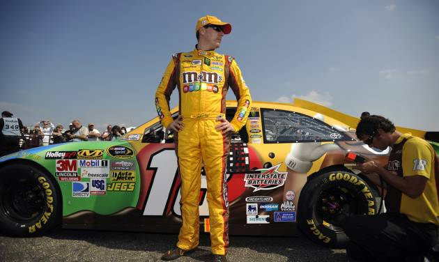 NASCAR driver Kyle Busch stands next to his car following his qualifying attempt at Talladega Superspeedway in Talladega, Ala., Saturday, Oct. 6, 2012. The drivers were qualifying for the Sunday running of the NASCAR Sprint Cup Series auto race. (AP Photo/Rainier Ehrhardt)