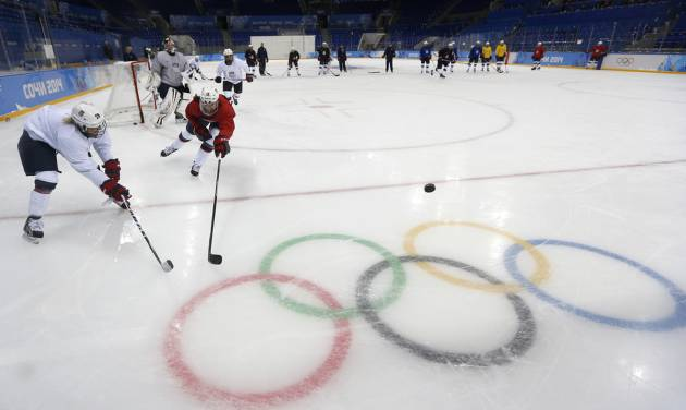 Meghan Duggan, right, of the U.S. women's ice hockey team challenges her teammate Amanda Kessel, left, during their practice session ahead of the 2014 Winter Olympics, Thursday, Feb. 6, 2014, in Sochi, Russia. (AP Photo/Petr David Josek)