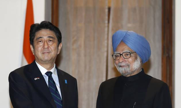 Japanese Prime Minister Shinzo Abe, left, poses with Indian Prime Minister Manmohan Singh for photographers before a meeting in New Delhi, India, Saturday, Jan. 25, 2014. Abe arrived Saturday on a three-day official visit to India and will also be the Chief Guest on India's Republic Day parade, celebrated on Jan. 26. (AP Photo/Saurabh Das)