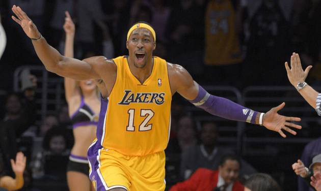Los Angeles Lakers center Dwight Howard celebrates after hitting a three point shot during the second half of their NBA basketball game against the Denver Nuggets, Friday, Nov. 30, 2012, in Los Angeles. The Lakers won 122-103. (AP Photo/Mark J. Terrill)  ORG XMIT: LAS108
