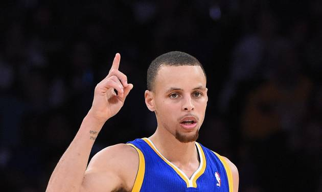 Golden State Warriors guard Stephen Curry gestures after scoring during the second half of an NBA basketball game against the Los Angeles Lakers, Friday, April 11, 2014, in Los Angeles. Curry had a triple-double as the Warriors won 112-95. (AP Photo/Mark J. Terrill)