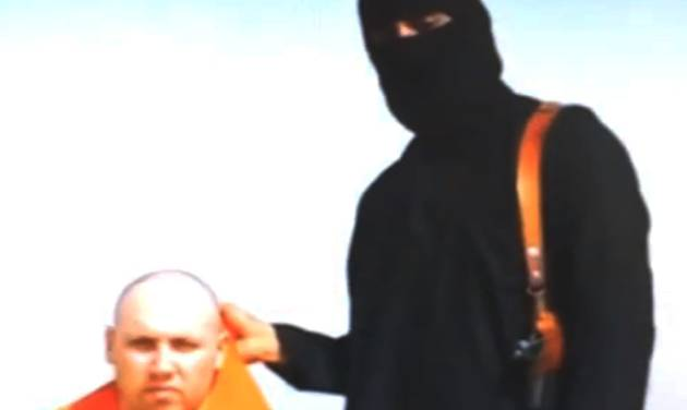FILE - In this  file still image from an undated video released by Islamic State militants on Tuesday, Aug. 19, 2014, purports to show journalist Steven Sotloff being held by the militant group. An Internet video purporting to show the beheading of U.S. journalist Sotloff by the Islamic State group was posted online Tuesday, a beheading described as retribution for continued U.S. airstrikes in Iraq. (AP Photo, File)