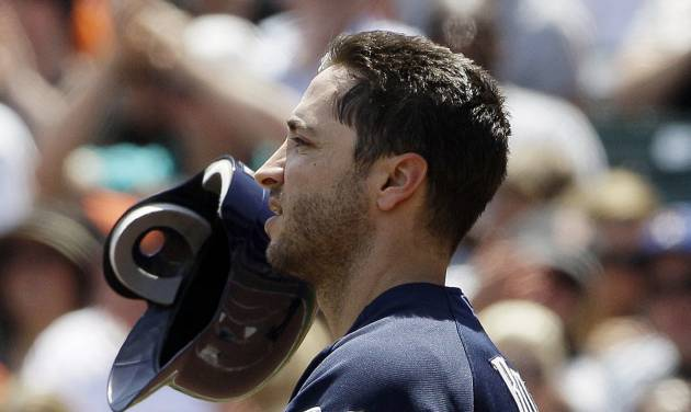 Milwaukee Brewers' Ryan Braun tosses his helmet after striking out against San Francisco Giants pitcher Matt Cain during the third inning of a baseball game in San Francisco, Sunday, May 6, 2012. The Giants won 4-3 in 11 innings. (AP Photo/Jeff Chiu)