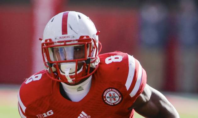 FILE - This Nov. 29, 2013 file photo shows Nebraska running back Ameer Abdullah with the ball in the second half of an NCAA college football game against Iowa in Lincoln, Neb. Abdullah averaged 130 yards a game and is the nation's top returning rusher. Abdullah and Wisconsin's Melvin Gordon are the nation's top two returning rushers and keys to their teams' bids to win the Big Ten West. (AP Photo/Nati Harnik, File)