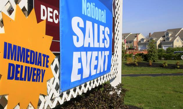FILE- This April 21, 2012 file photo shows a house sale sign is seen at a development in Newtown, Pa. The government's monthly jobs report has become Washington's most anticipated and studied economic indicator _ pounced upon by politicians, economists and journalists for snap judgments as the presidential election nears. But in the real world, most everybody else just looks around and figures things out for themselves. (AP Photo/Mel Evans, File)