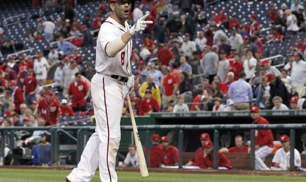 Washington Nationals' Danny Espinosa talks about the call after striking out swing for the final out of a baseball game against the Cincinnati Reds at Nationals Park on Wednesday, May 21, 2014, in Washington. The Reds won 2-1. (AP Photo/Alex Brandon)