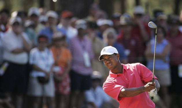 FILE - In this June 16, 2005, file photo, Tiger Woods chips to the 15th hole during the first round of the U.S. Open golf tournament, at Pinehurst's No, 2 Course in Pinehurst, N.C. Woods withdrew from the U.S. Open on Wednesday, May 28, 2014, as he recovers from back surgery that has kept him out of golf for nearly three months. It will be the second U.S. Open, and sixth major, he has missed because of injury over the last six years. The U.S. Open is June 12-15 at Pinehurst No. 2, where Woods tied for third in 1999 and was runner-up in 2005. (AP Photo/Julie Jacobson, File)