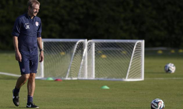 United States' head coach Jurgen Klinsmann walks a practice field during a training session in Sao Paulo, Brazil, Monday, June 23, 2014. The United States will play Germany in group G of the 2014 soccer World Cup on June 26 in Recife, Brazil. (AP Photo/Julio Cortez)