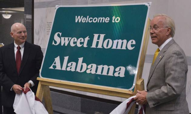 "John Cooper, left, Alabama Department of Transportation Director, and Lee Sentell, Alabama Department of Tourism and Travel Director, unveil the new 'Welcome to Sweet Home Alabama' sign on Friday, July 18, 2014. State tourism and transportation officials said the ""Alabama The Beautiful"" signs that have stood at the state line since 2003 will be replaced over the next few months. (AP Photo/The Montgomery Advertiser, Lloyd Gallman)  NO SALES"