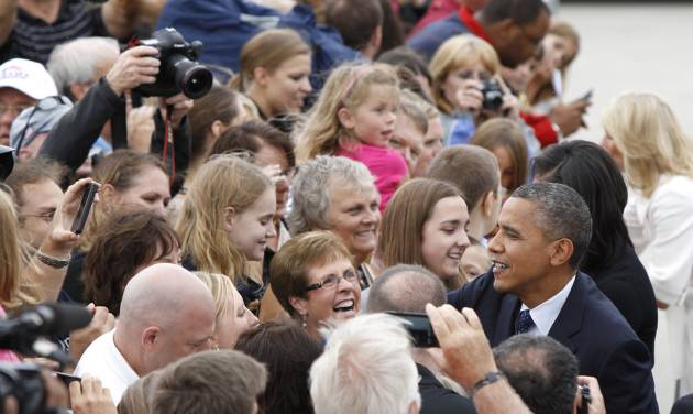 President Barack Obama shakes hands with the crowd gathered Friday, Sept. 7, 2012, at the Eastern Iowa Airport in Cedar Rapids, Iowa. (AP Photo/Matthew Putney)