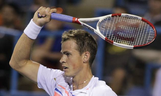 Vasek Pospisil, of Canada,  returns the ball to Tomas Berdych, of the Czech Republic, at the Citi Open tennis tournament, Thursday, July 31, 2014, in Washington. (AP Photo/Luis M. Alvarez)