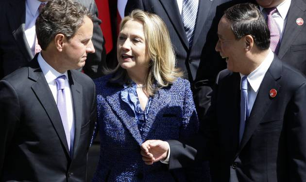 Chinese Vice Premier Wang Qishan, right, talks to U.S. Treasury Secretary Timothy Geithner, left, and U.S. Secretary of State Hillary Rodham Clinton as they attend a group photo after the opening ceremony of U.S.-China Strategic and Economic Dialogue at the Diaoyutai state guesthouse in Beijing, Thursday, May 3, 2012. (AP Photo/Jason Lee, Pool)
