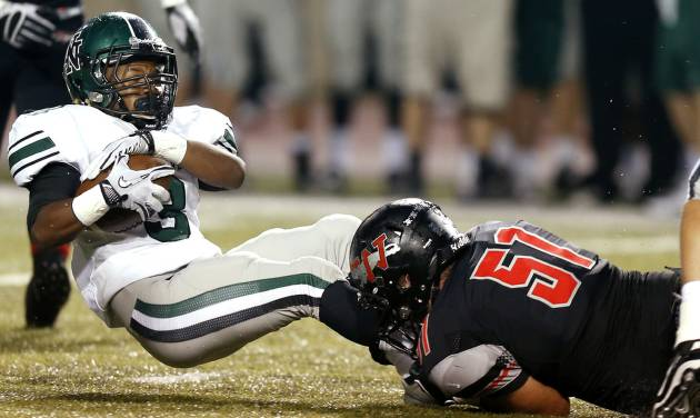 Norman North's Bryan Payne is brought down by Westmoore's Zach Clark during a high school football game in Moore, Okla., Thursday, September 13, 2012. Photo by Bryan Terry, The Oklahoman