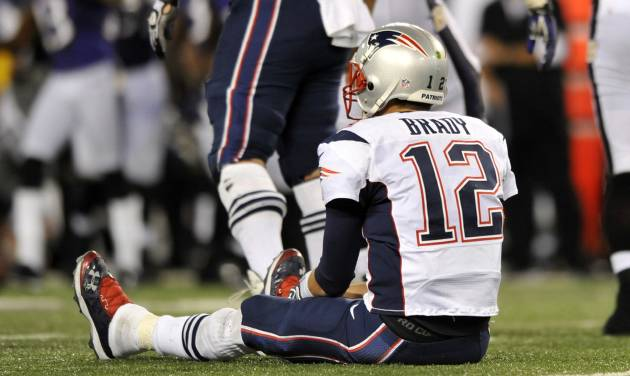 New England Patriots quarterback Tom Brady looks on after not being able to convert for a first down in the second half of an NFL football game against the Baltimore Ravens in Baltimore, Sunday, Sept. 23, 2012. Baltimore won 31-30. (AP Photo/Gail Burton)