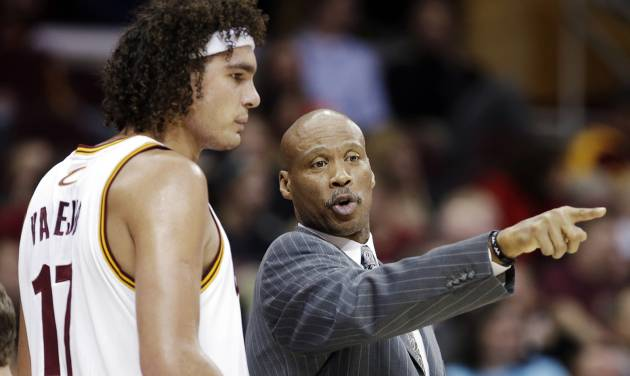 Cleveland Cavaliers head coach Byron Scott, right, instructs Anderson Varejao, of Brazil, in the first half of an NBA basketball game against the Toronto Raptors, Tuesday, Dec. 18, 2012, in Cleveland. Toronto won 113-99. (AP Photo/Mark Duncan)