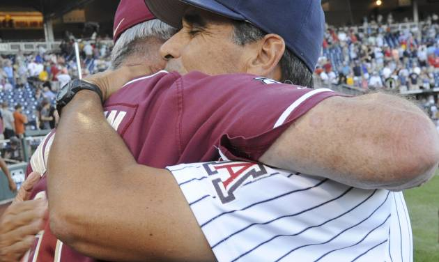 Florida State coach Mike Martin, left, and Arizona coach Andy Lopez hug following an NCAA College World Series baseball game in Omaha, Neb., Thursday, June 21, 2012. Arizona defeated Florida State 10-3. (AP Photo/Dave Weaver)