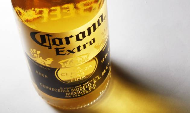FILE - This Oct. 5, 2010 file photo shows a bottle of Corona Extra beer in Philadelphia. Anheuser-Bush InBev changed the terms of its proposed $20.1 billion acquisition of Mexican brewer Grupo Modelo, the maker of Corona, Thursday, Feb. 14, 2013 in an attempt to push through a deal that federal regulators say would have killed competition. (AP Photo/Matt Rourke, File)
