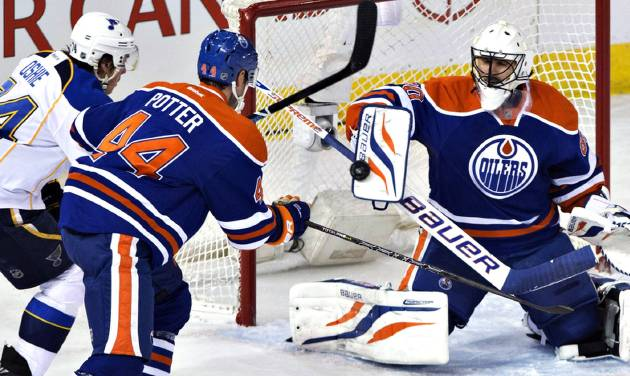 St. Louis Blues' T.J. Oshie (74) and Edmonton Oilers' Corey Potter (44) look for the rebound as Oilers goalie Ilya Bryzgalov (80) makes the save during the second period of an NHL hockey game in Edmonton, Alberta, on Saturday, Dec. 21, 2013. (AP Photo/The Canadian Press, Jason Franson)
