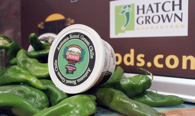 Fresh green chile and chile products are displayed as state officials announce a new certification program aimed at protecting the reputation and integrity of New Mexico-grown chile during an event at The Range restaurant in Bernalillo, N.M., on Tuesday, Aug. 19, 2014. The restaurant is the first to sign up to participate in the program. (AP Photo/Susan Montoya Bryan)