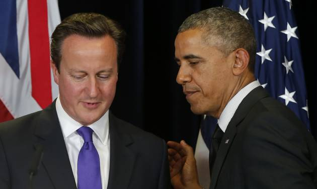 President Barack Obama and British Prime Minister David Cameron finish a news conference at the G7 summit in Brussels, Belgium, Thursday, June 5, 2014. (AP Photo/Charles Dharapak)