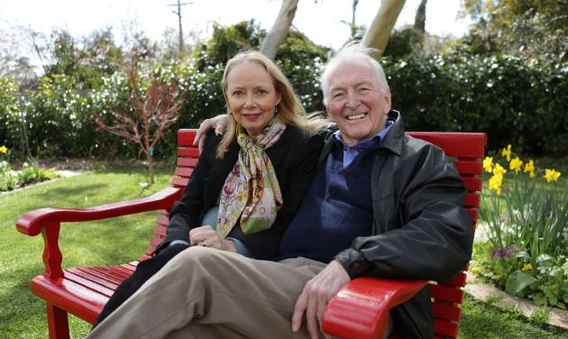 """In this Aug. 30, 2012 photo provided by Penguin Books, Australian best-selling author Bryce Courtenay poses with wife Christine Gee on a park bench in Canberra Australia Courtenay, author of """"The Power Of One"""" and 20 other titles died Thursday Nov. 22, 2012 of stomach cancer. He was 79. (AP Photo/Penguin Books) EDITORIAL USE ONLY, NO SALES"""