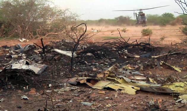 This photo provided Friday July 25, 2014 by the French army shows a helicopter at the site of the plane crash in Mali. French soldiers secured a black box from the Air Algerie wreckage site in a desolate region of restive northern Mali on Friday, the French president said. Terrorism hasn't been ruled out as a cause, although officials say the most likely reason for the catastrophe that killed all onboard is bad weather. At least 116 people were killed in Thursday's disaster, nearly half of whom were French. (AP Photo/ECPAD)