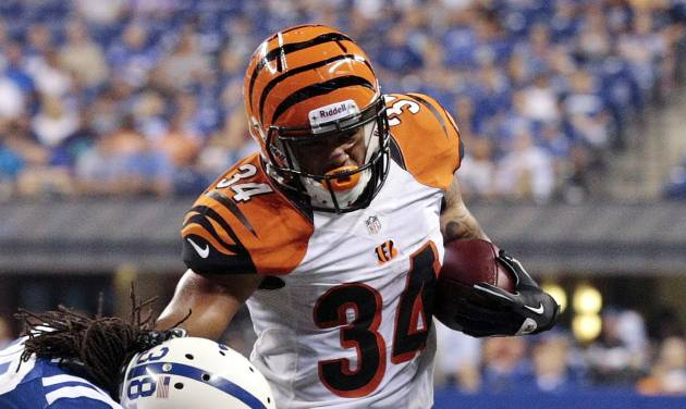 Cincinnati Bengals running back Dan Herron (34) tries to get past Indianapolis Colts defensive back Mike Newton in the second half of an NFL preseason football game in Indianapolis, Thursday, Aug. 30, 2012. (AP Photo/AJ Mast)