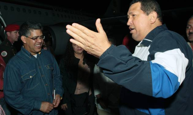 In this photo released by Miraflores Press Office, Venezuela's President Hugo Chavez, right, speaks with Vice President Elias Jaua upon his arrival to the airport in Maiquetia near Caracas, Venezuela, Thursday, April 26, 2012. Chavez has returned home after 11 days in Cuba where he was undergoing radiation therapy treatment. (AP Photo/Miraflores Press Office, Efrain Gonzalez)