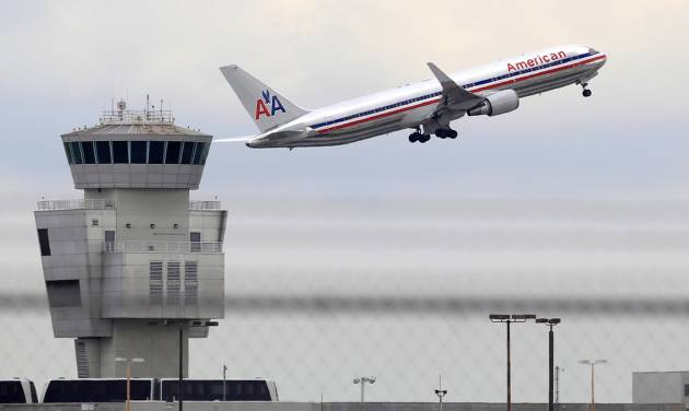 FILE - In this Friday, Oct. 14, 2011 photo, an American Airlines Boeing 767 takes off from Miami International Airport, in Miami. American Airlines Group Inc. releases quarterly financial results before the market opens on Thursday, April 24, 2014. (AP Photo/Wilfredo Lee, File)