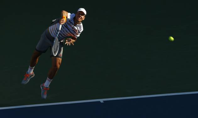 Tomas Berdych, of the Czech Republic, serves against  Martin Klizan, of Slovakia, during the second round of the 2014 U.S. Open tennis tournament, Friday, Aug. 29, 2014, in New York. (AP Photo/Matt Rourke)