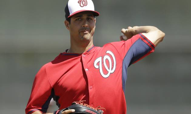 Washington Nationals starting pitcher Gio Gonzalez warms up before a spring exhibition baseball game against the Houston Astros in Kissimmee, Fla., Sunday, March 16, 2014. (AP Photo/Carlos Osorio)