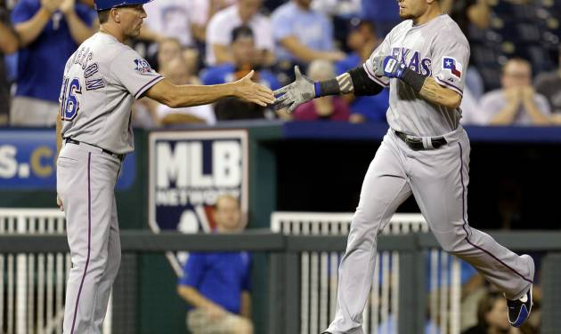 Texas Rangers' Josh Hamilton, right, celebrates with third base coach Dave Anderson after hitting a two-run home run during the fourth inning of a baseball game against the Kansas City Royals, Thursday, Sept. 6, 2012, in Kansas City, Mo. (AP Photo/Charlie Riedel)