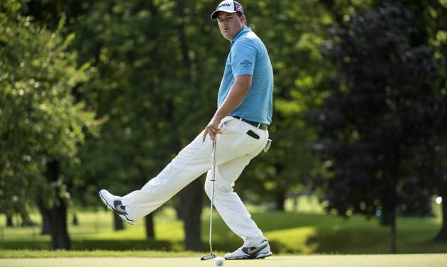 Michael Putnam, of the United States, reacts after missing a birdie putt on the 18th hole during first-round play at the Canadian Open golf championship on Thursday, July 24, 2014, in Montreal. (AP Photo/The Canadian Press, Paul Chiasson)