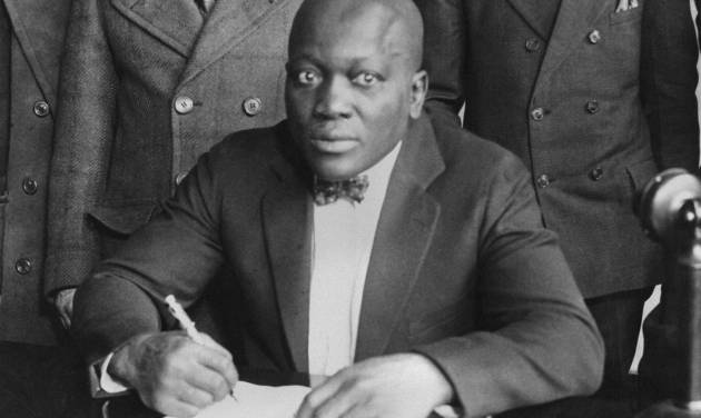 Boxer Jack Johnson is shown signing contracts in this undated photo. Relatives and hometown supporters of boxing's first black heavyweight champion are turning to YouTube to convince the president to posthumously pardon him of a 1913 conviction for accompanying a white woman across state lines, Tuesday, April 2, 2013. (AP Photo/file)
