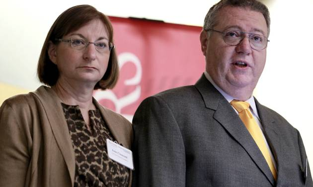 FILE - Joseph Clementi, right, and his wife Jane Clementi open a symposium on use and misuse of social media at Rutgers University, in this Nov. 14, 2011 file photo taken in Piscataway, N.J. The parents of a Rutgers University student who killed himself after his roommate used a webcam to see him kissing another man have decided not to sue anyone. Their family attorney Paul Mainardi told the Star-Ledger of Newark Thursday Oct. 4, 2012 they are devoting their energies to the foundation that they established in their son's name. (AP Photo/Julio Cortez, File)