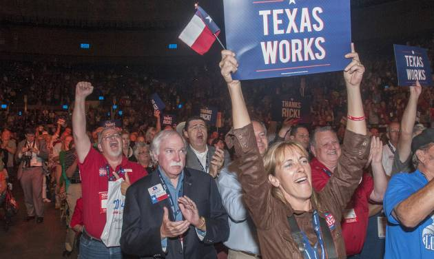 Delegates to the Texas GOP Convention cheer for Gov. Rick Perry after his speech in Fort Worth, Texas on Thursday, June, 5, 2014. In his address, the longest-serving governor in the state's history focused more on the future and national issues than his political legacy at home. (AP Photo/Rex C. Curry)