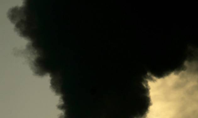 FILE - In this Feb. 2, 2007 file photo vapors  spew from the smokestack at Sunflower Electric Cooperative's coal-fired power plant in Holcomb, Kan. The U.S. Environmental Protection Agency's administrator announced the new regulations for decreasing greenhouse gas emissions Monday, June 2, 2014, in Washington. According to the EPA, Kansas' goal would be to cut emissions 23 percent by 2030. (AP Photo/Charlie Riedel, File)