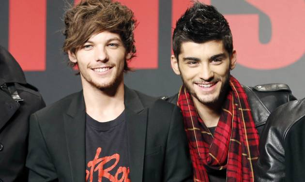 "FILE - This Nov. 3, 2013 file photo shows One Direction members Louis Tomlinson, left, and Zayn Malik during an event for their film ""One Direction: This Is US,"" in Makuhari, near Tokyo, Sunday, Nov. 3, 2013.  A representative for One Direction says the band's lawyers are dealing with a video showing two band members smoking what the singers referred to as an ""illegal substance."" British tabloid The Daily Mail posted a five-minute clip Tuesday, May 27, 2014, of Zayn Malik smoking and speaking with Louis Tomlinson, who is filming.  (AP Photo/Koji Sasahara, File)"
