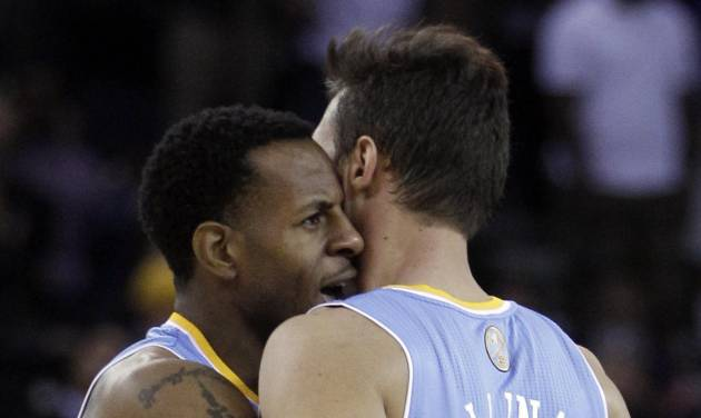 Denver Nuggets' Andre Iguodala, left, embraces teammate Danilo Gallinari during double overtime in an NBA basketball game against the Golden State Warriors Saturday, Nov. 10, 2012, in Oakland, Calif. (AP Photo/Ben Margot)