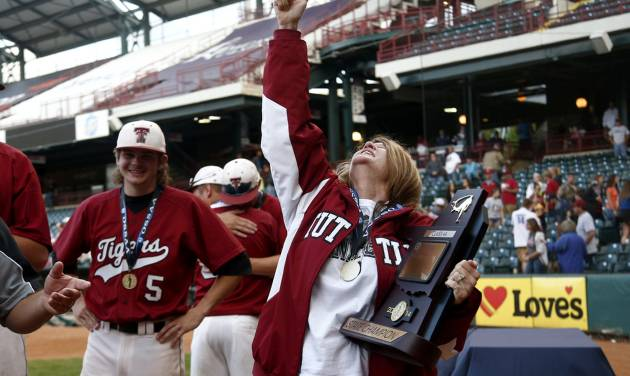 Kim Tiderman looks up after receiving the 4A state baseball championship trophy during the class 4A state baseball championship game between Tuttle and Dewey at the Chickasaw Bricktown Ballpark in Oklahoma City, Saturday, May 17, 2014. Photo by Sarah Phipps, The Oklahoman