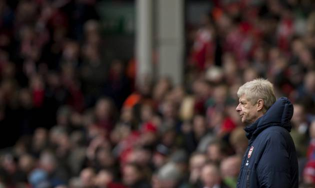 Arsenal's manager Arsene Wenger watches his team's English Premier League soccer match against Liverpool at Anfield Stadium, Liverpool, England, Saturday Feb. 8, 2014. (AP Photo/Jon Super)