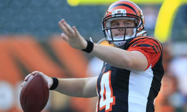 FILE - In this Aug. 23, 2012 file photo, Cincinnati Bengals quarterback Andy Dalton warms up prior to an NFL football game against the Green Bay Packers, in Cincinnati. Dalton and A.J. Green made the Pro Bowl together in their first go-around. There will be a lot more on them this time around. (AP Photo/Al Behrman, File)