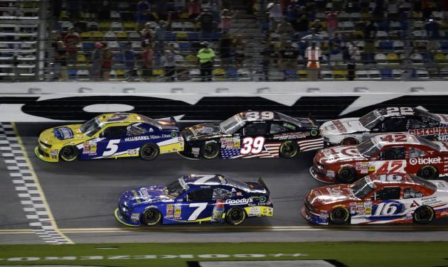 Kasey Kahne (5) makes it to the finish line ahead of Regan Smith (7) to win the NASCAR Nationwide series auto race followed by Ryan Sieg (39), Ryan Reed (16), Kyle Larson (42) and Joey Logano (22) at Daytona International Speedway in Daytona Beach, Fla., Friday, July 4, 2014. (AP Photo/John Raoux)