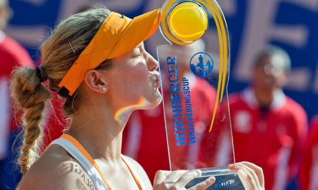Canadian Eugenie Bouchard kisses the trophy after defeating Czech  Karolina Pliskova at the WTA final in Nuremberg, Germany, Saturday, May 24, 2014. Bouchard won 6-2, 4-6, 6-3. (AP Photo/dpa, Daniel Karmann)