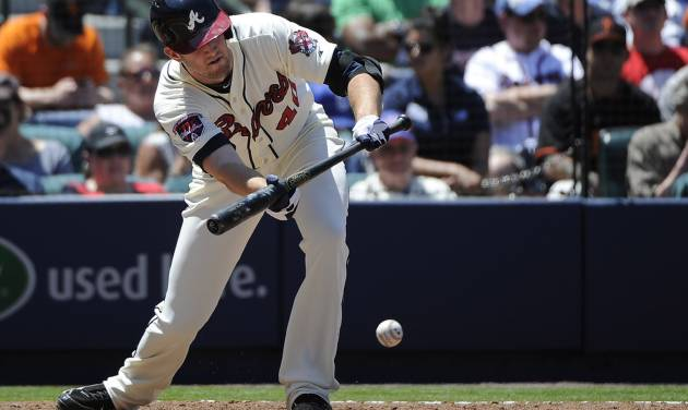 Atlanta Braves' Alex Wood bunts against the San Francisco Giants and advances to first base on a throwing error during the third inning of a baseball game on Sunday, May 4, 2014, in Atlanta. (AP Photo/David Tulis)