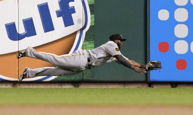 Pittsburgh Pirates right fielder Josh Harrison makes a diving catch on a ball hit by St. Louis Cardinals' Jhonny Peralta in the second inning of a baseball game, Monday, July 7, 2014 in St. Louis. (AP Photo/Tom Gannam)