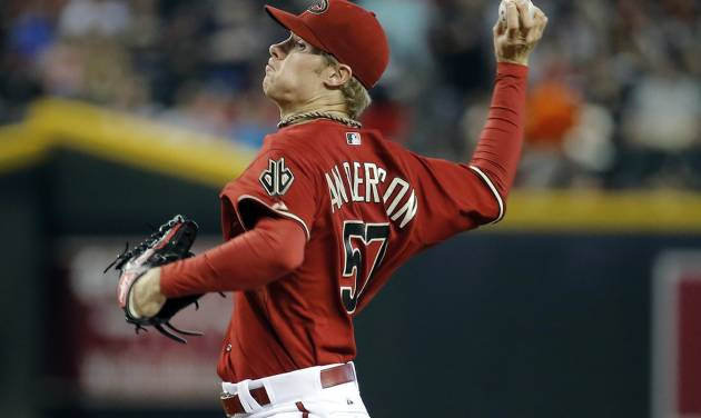 Arizona Diamondbacks pitcher Chase Anderson throws against the Atlanta Braves during the first inning of a baseball game, Sunday, June 8, 2014, in Phoenix. I (AP Photo/Matt York)