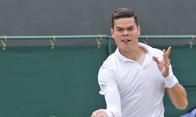 Milos Raonic of Canada returns to Jack Sock of the U.S. during their men's singles match at the All England Lawn Tennis Championships in Wimbledon, London, Thursday, June 26, 2014. (AP Photo/Ben Curtis)